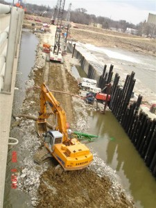 Heavy Marine Construction Equipment Shoring Up Dam